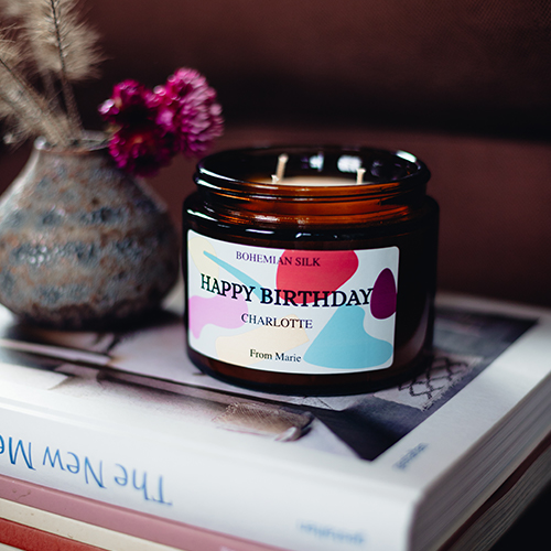 brown personalized candle with text happy birthday