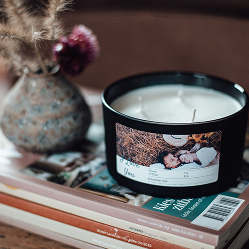 black scented candle with photo of couple