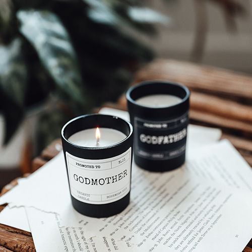 black scented candle with text godmother
